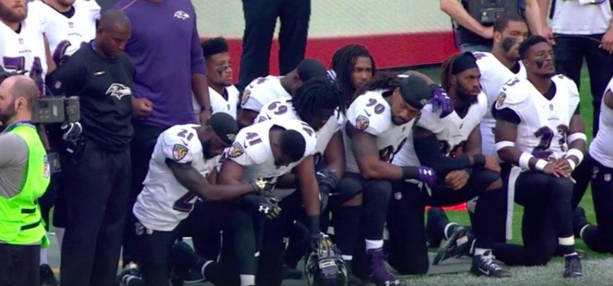 LOOK: Ravens, Jaguars respond to Trump's comments with large protest in London