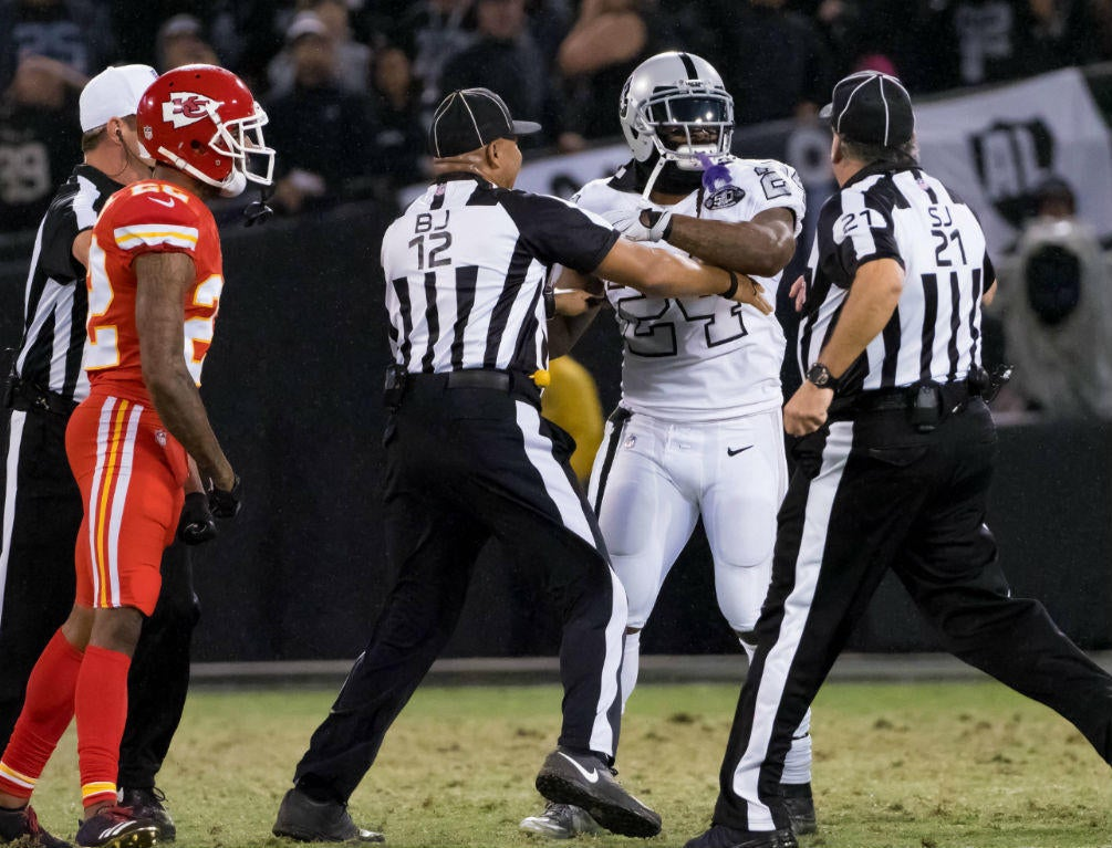 LOOK: Marshawn Lynch runs on field during scuffle, gets ejected for shoving ref