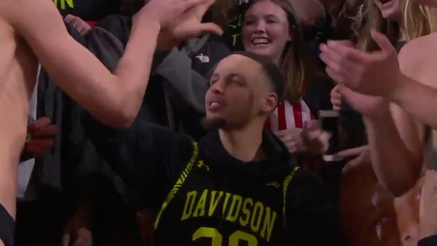 26b07d36895 Warriors  Stephen Curry gives new uniforms to Davidson then celebrates a  comeback victory in the student section