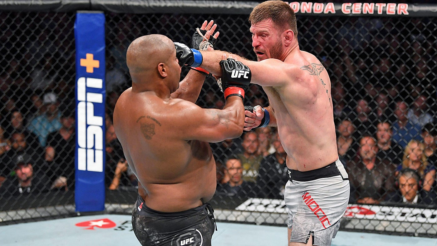 Miocic landed 7-8 unanswered punches as Cormier slumped against the cage wall before Herb Dean jumped in.