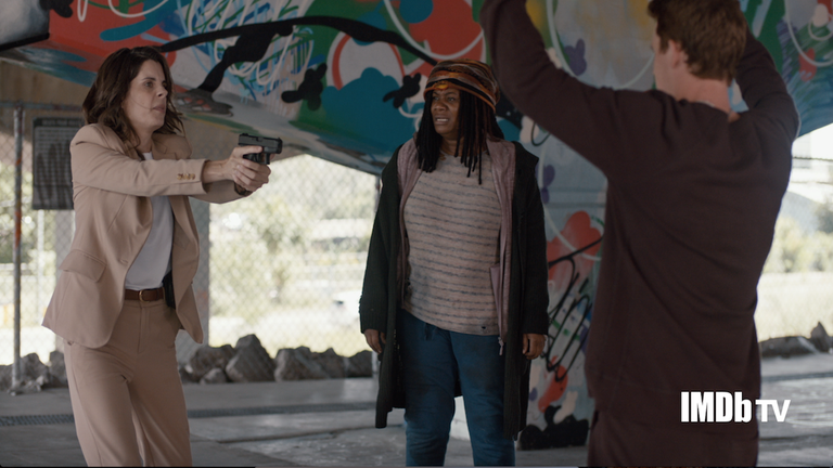 Adrienne C. Moore and Meredith MacNeill Face off at Gunpoint in 'Pretty Hard Cases' Exclusive Clip