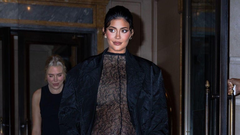 Kylie Jenner Bares Baby Bump in See-Through Lace Jumpsuit