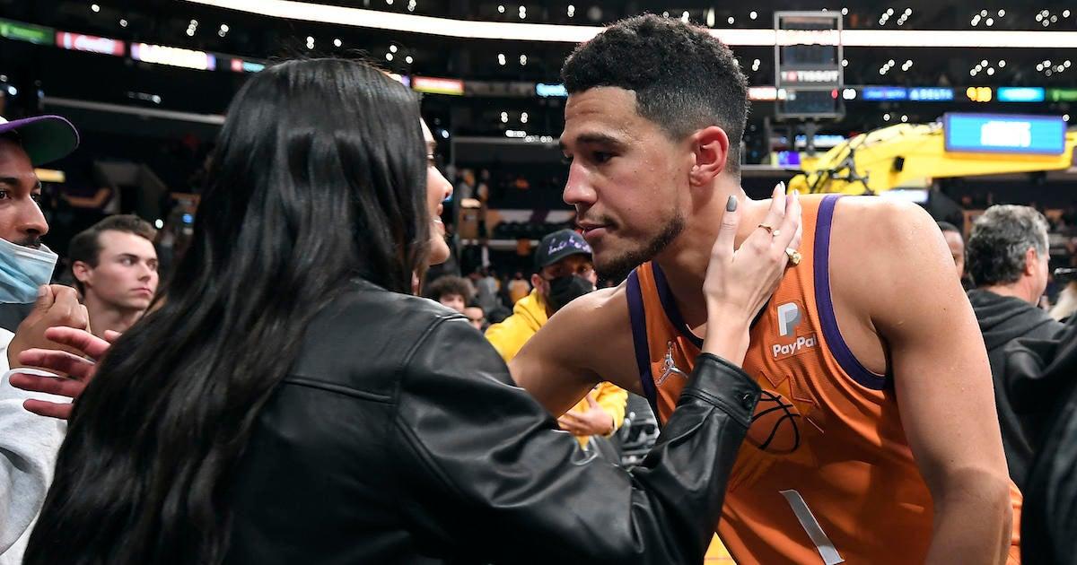 Devin Booker Kisses Kendall Jenner in Rare Courtside PDA.jpg