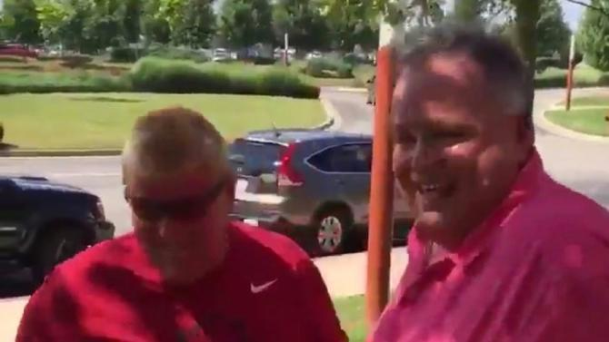 WATCH: John Daly hits tee shot out of a casino chairman's mouth