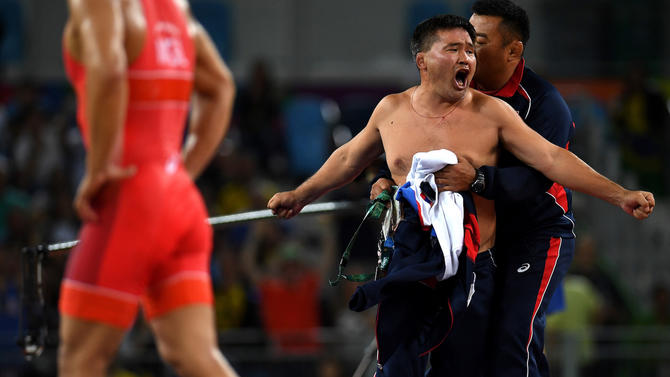 Mongolian Wrestling Coaches Strip in Protest After Rio Loss