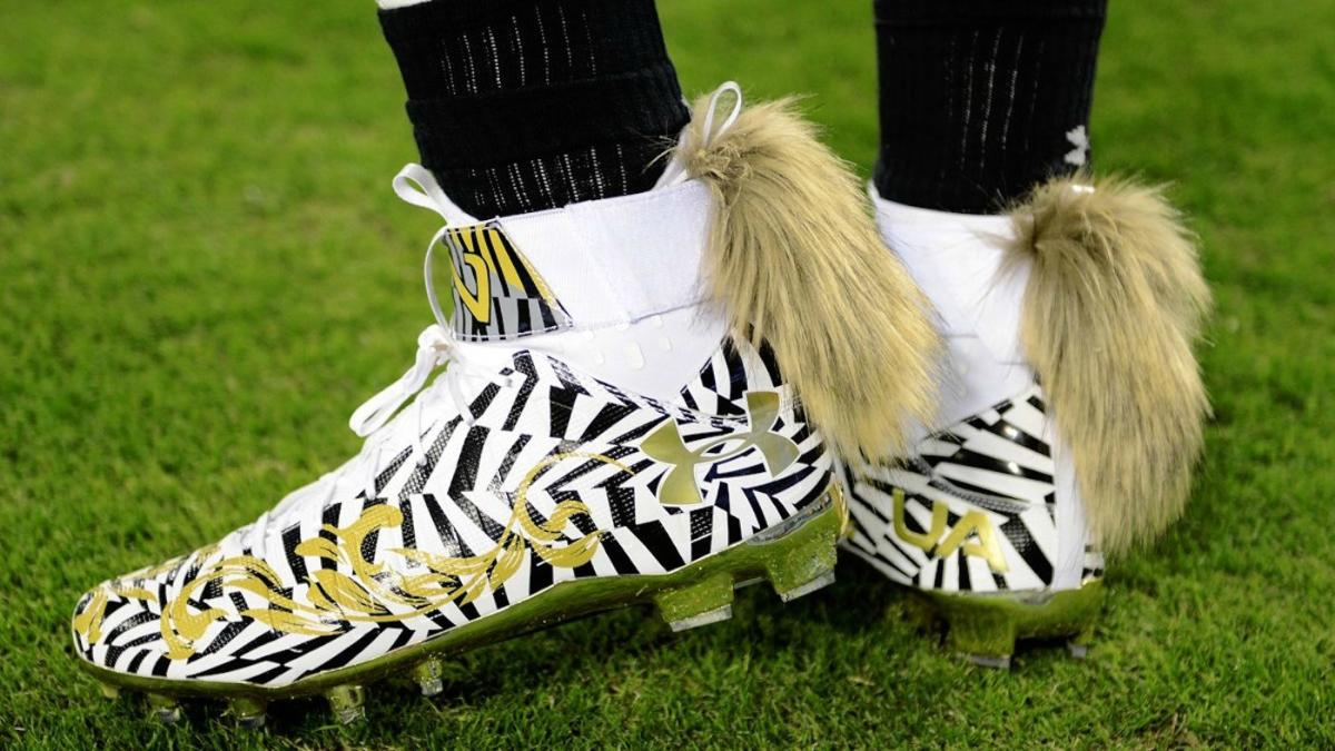 acb5ee8aede1 LOOK: Cam Newton's cleats have tails on them and are completely crazy -  CBSSports.com