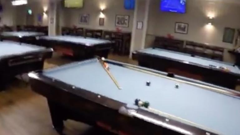Watch this ridiculous billiards, golf trick shot that took 11 hours to build