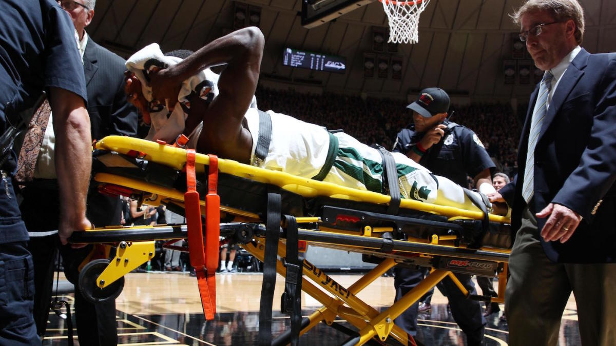 Michigan State's Eron Harris carted off the floor after