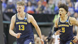 WATCH: Michigan upsets Louisville to advance to Sweet 16
