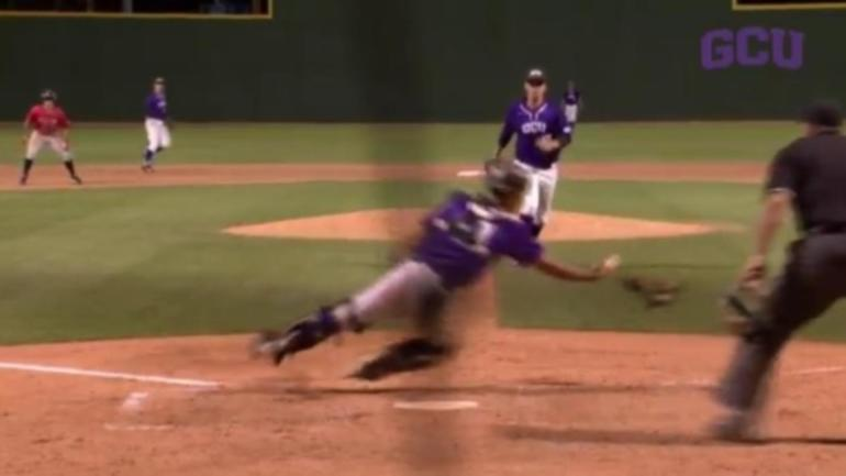 WATCH: College catcher makes incredible juggling catch on ...