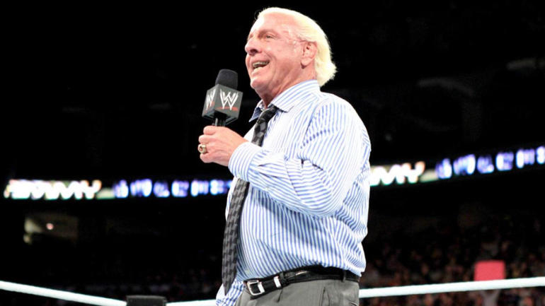 watch ric flair wearing an amazing shirt says he s back up and