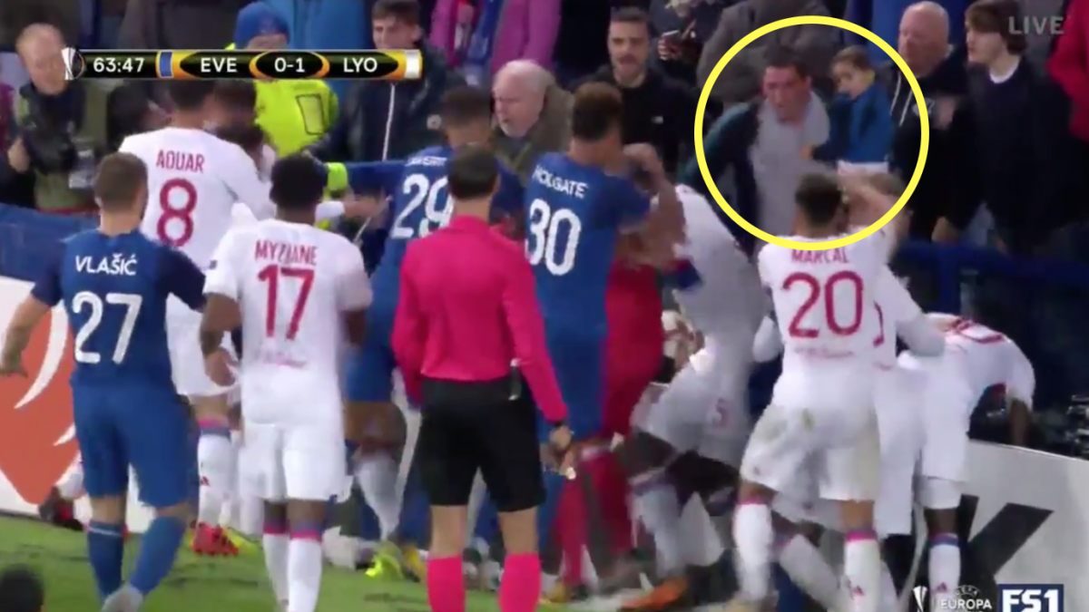 WATCH: Soccer dad tries to fight Europa League players while holding small child