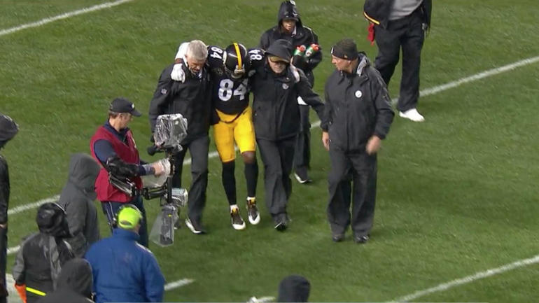 Antonio Brown carried off amid MVP chants after calf injury, won
