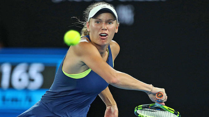 Australian open 2018 caroline wozniacki tops simona halep for first wozniacki wins her first grand slam title in her 43rd appearance getty images stopboris Images