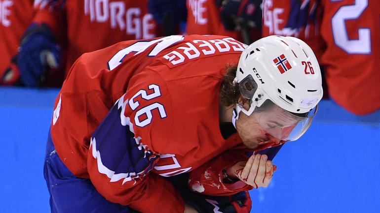 2018 Winter Olympics: Hockey player takes a flying skate ...
