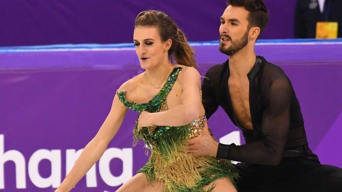 French Olympic Ice Dancer Endures Wardrobe Malfunction To