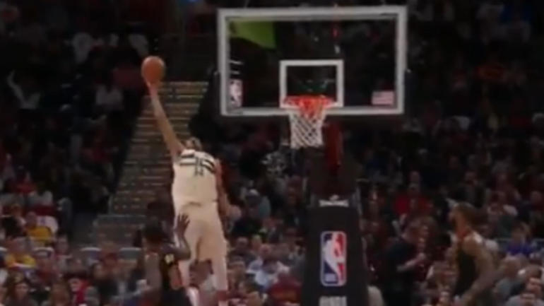 How on earth did Giannis Antetokounmpo catch and finish this alley-oop?