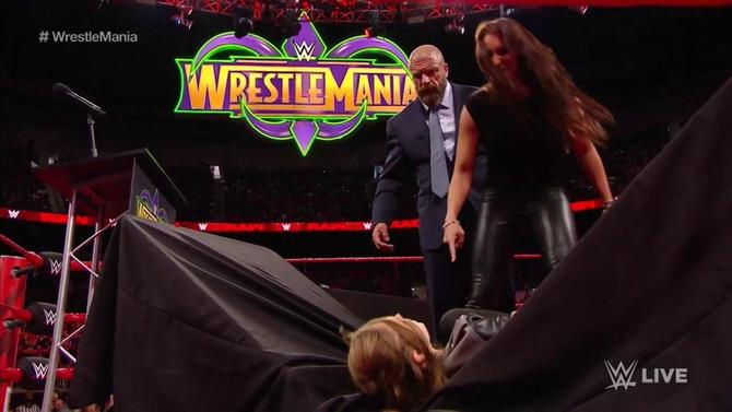 WATCH: Ronda Rousey slammed through a table on WWE