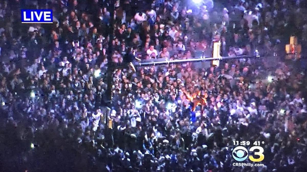 LOOK: Grease didn't work, Villanova fans climb light poles, light fires in Philadelphia after win