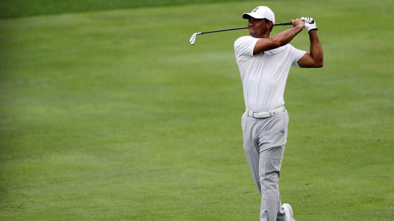 tiger woods score  tight back  early woes make par a