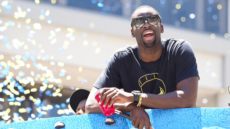 Warriors' Draymond Green takes a shot at Cavs' Tristan Thompson during championship parade