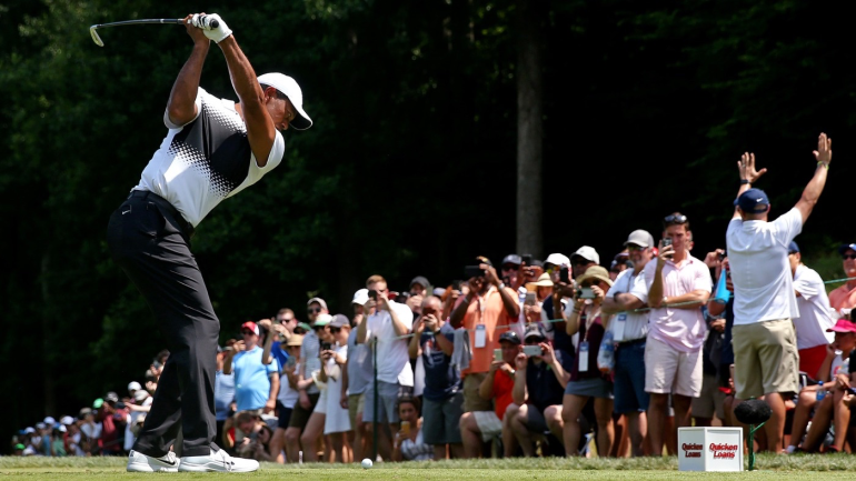 tiger woods score  roller coaster day ends with outside