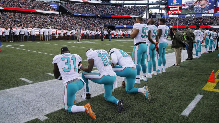 Two Dolphins players kneel during anthem as four preseason games feature some form of player protest