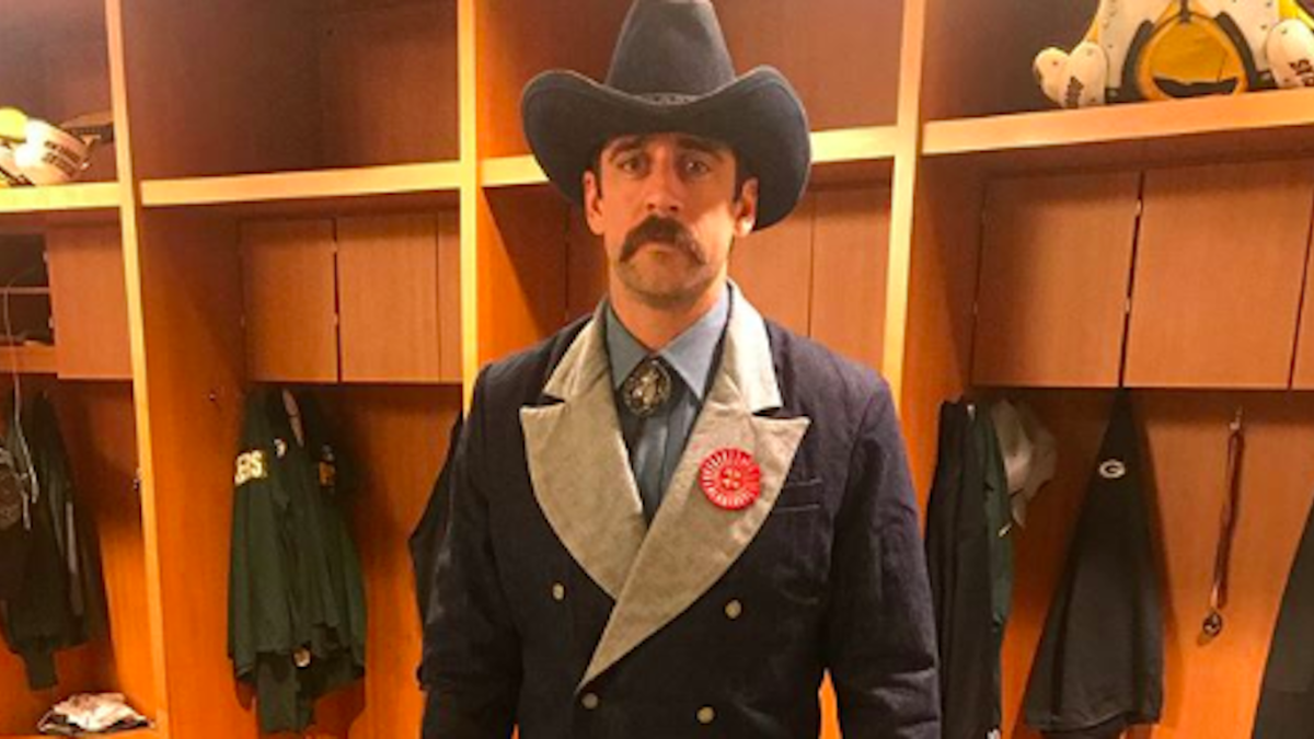 Aaron Rodgers reacts after signing the largest contract in NFL history