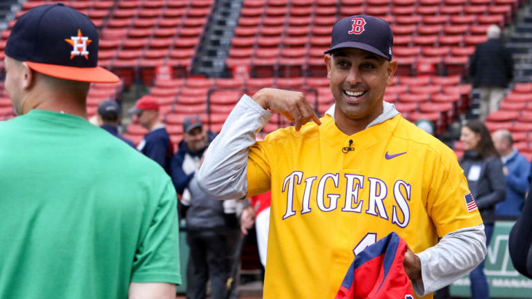 Red Sox manager Alex Cora wears LSU baseball jersey after losing college footbal...