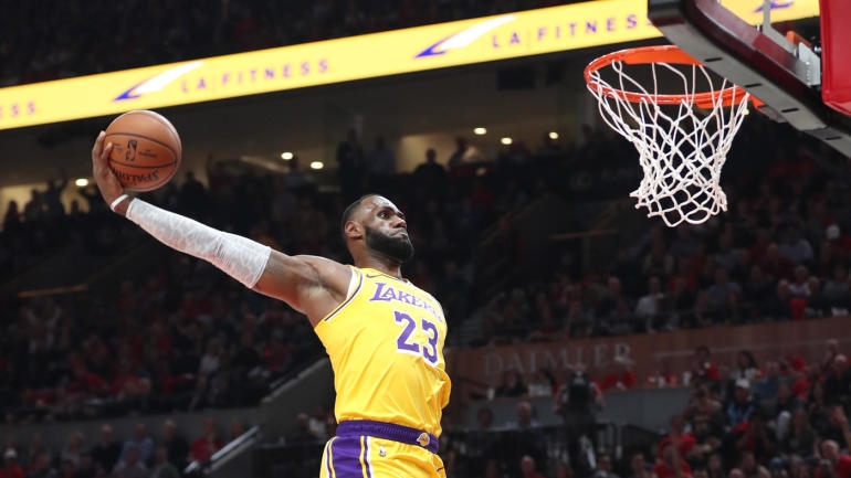 911473f1328 NBA highlights  LeBron James begins Lakers career with back-to-back vicious  dunks in debut - CBSSports.com