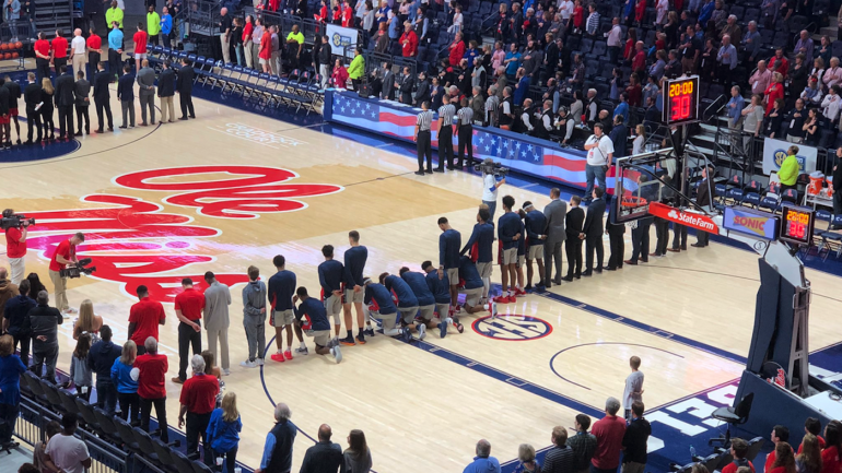 Ole Miss basketball players kneel during national anthem ...