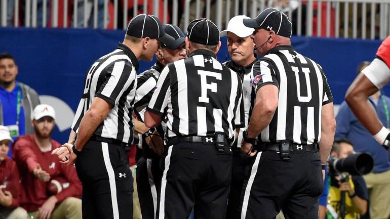 sec-officials-huddling.jpg