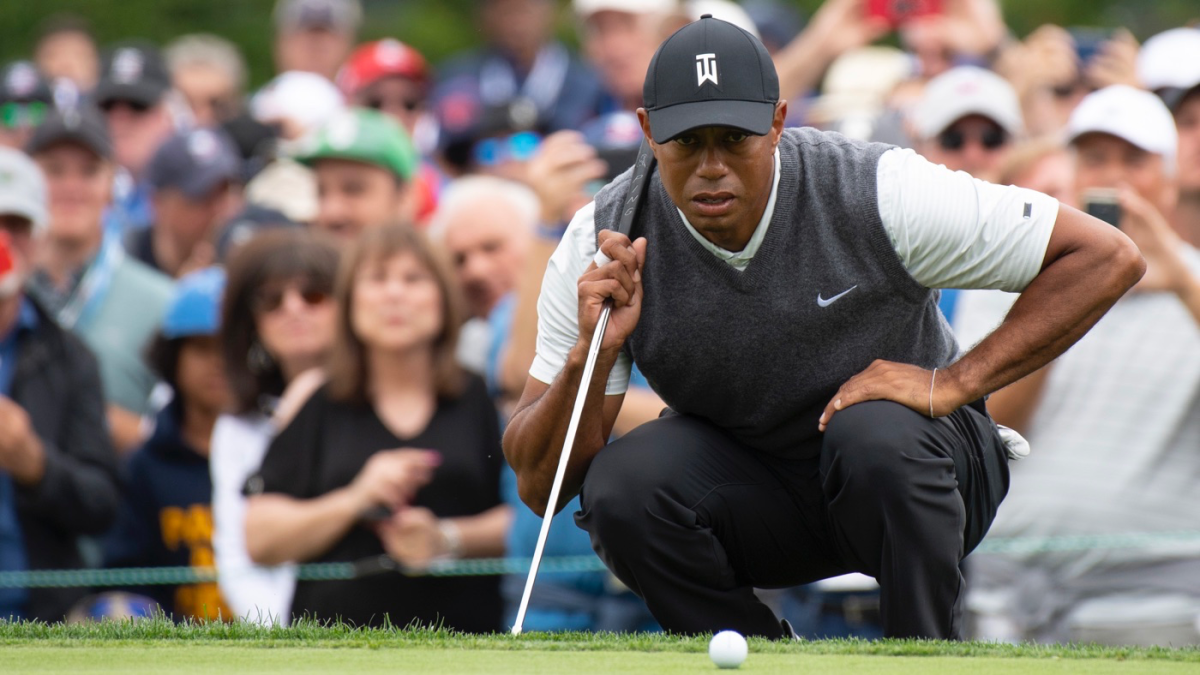 tiger woods score  putter holds together an up