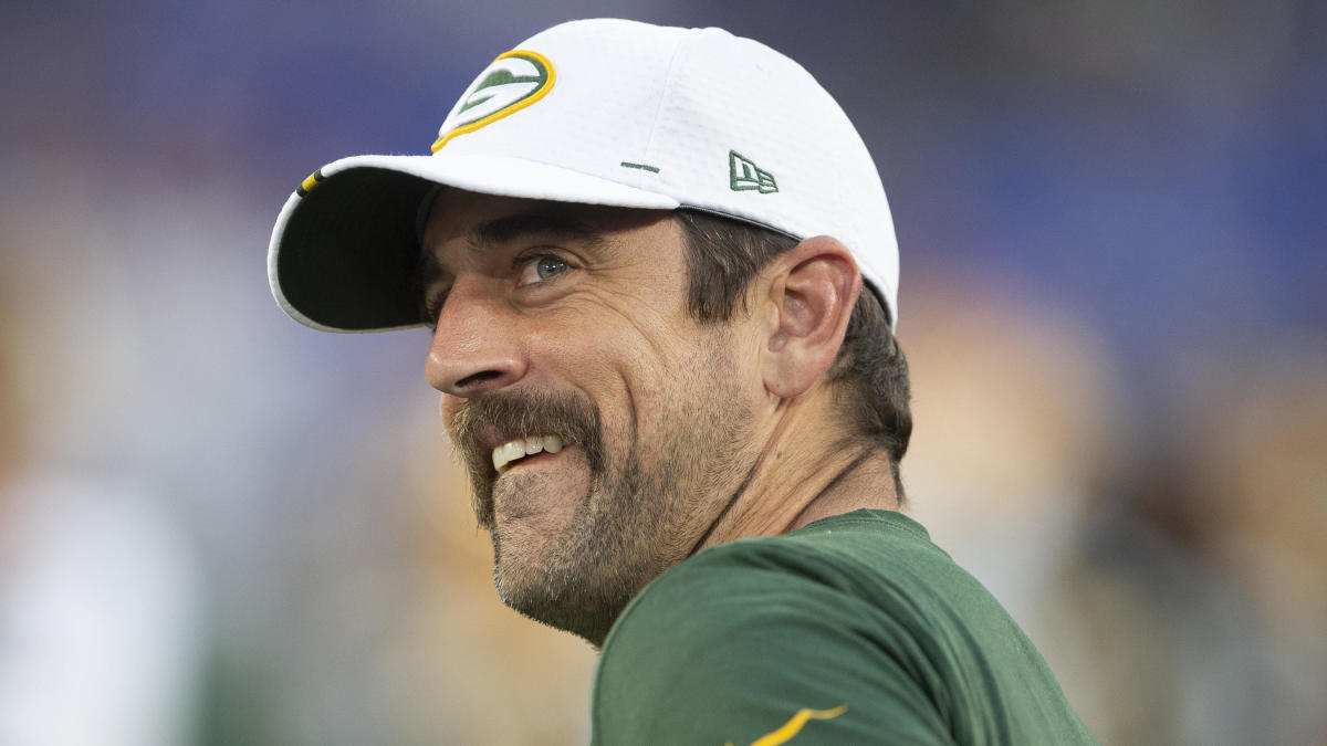 Aaron Rodgers and Packers quarterbacks dress as 'Happy Gilmore' characters for team event