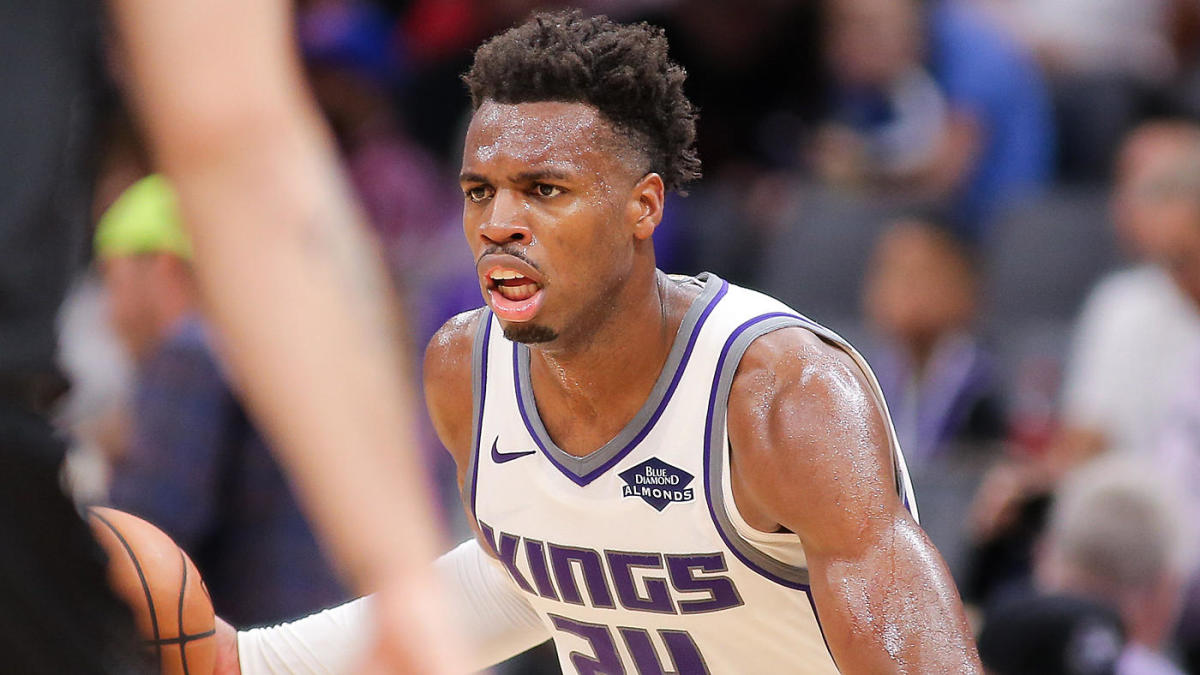 Buddy Hield makes money sign at Kings GM during team's fan fest as two sides continue contract negotiations