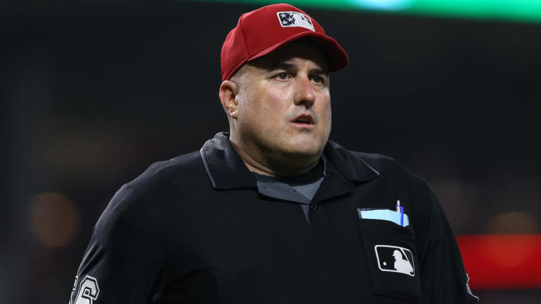 MLB umpire Eric Cooper, who worked in the majors for 21 seasons, dies at 52