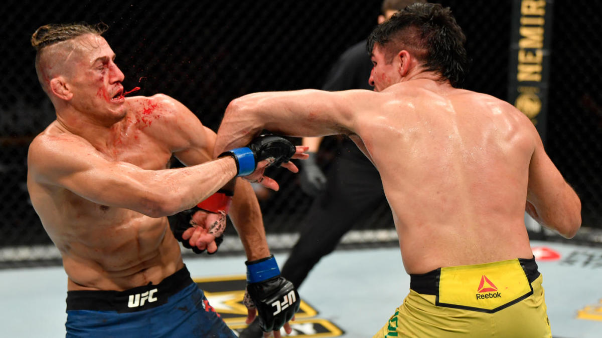 Volcánico Peluquero suspicaz  UFC 249 results, highlights: Vicente Luque wins bloody war over Niko Price  after devastating left hand - CBSSports.com
