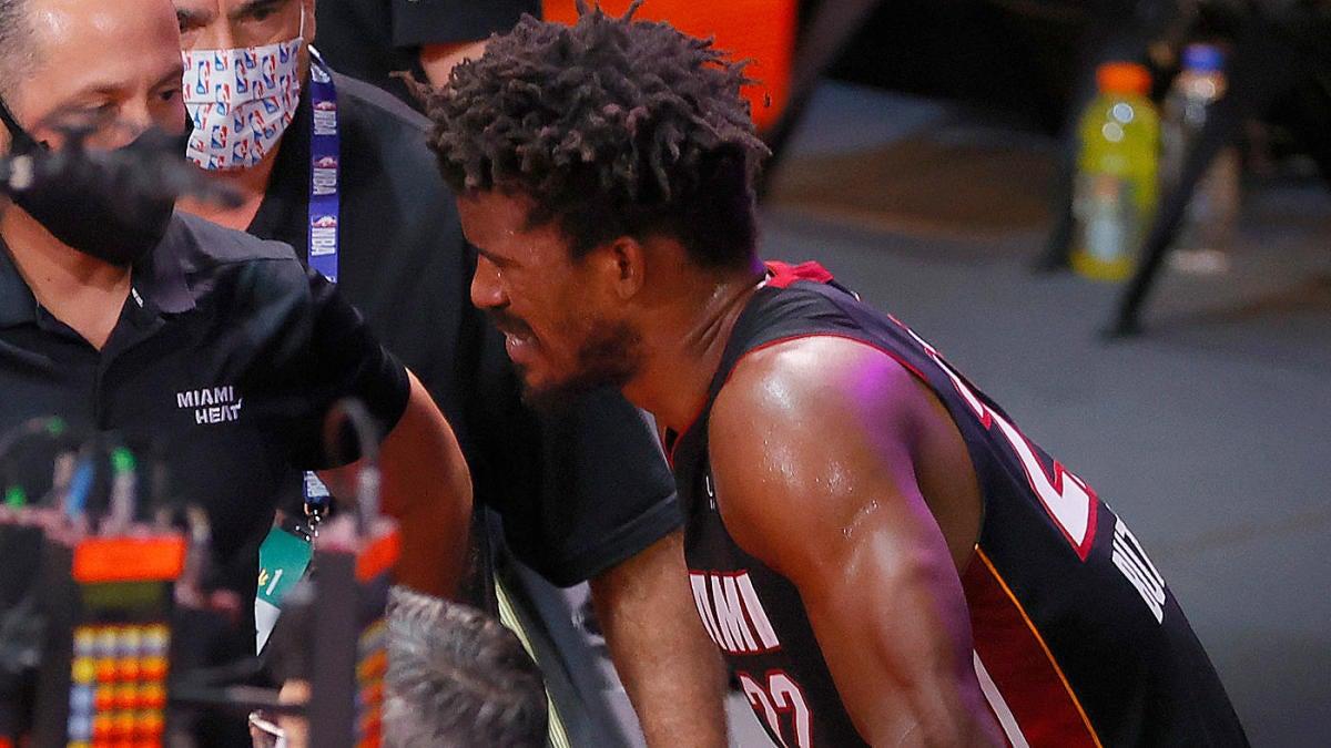 Heat S Jimmy Butler Rolls Ankle Goran Dragic Hurts Foot Bam Adebayo Exits Finals With Apparent Arm Injury Cbssports Com