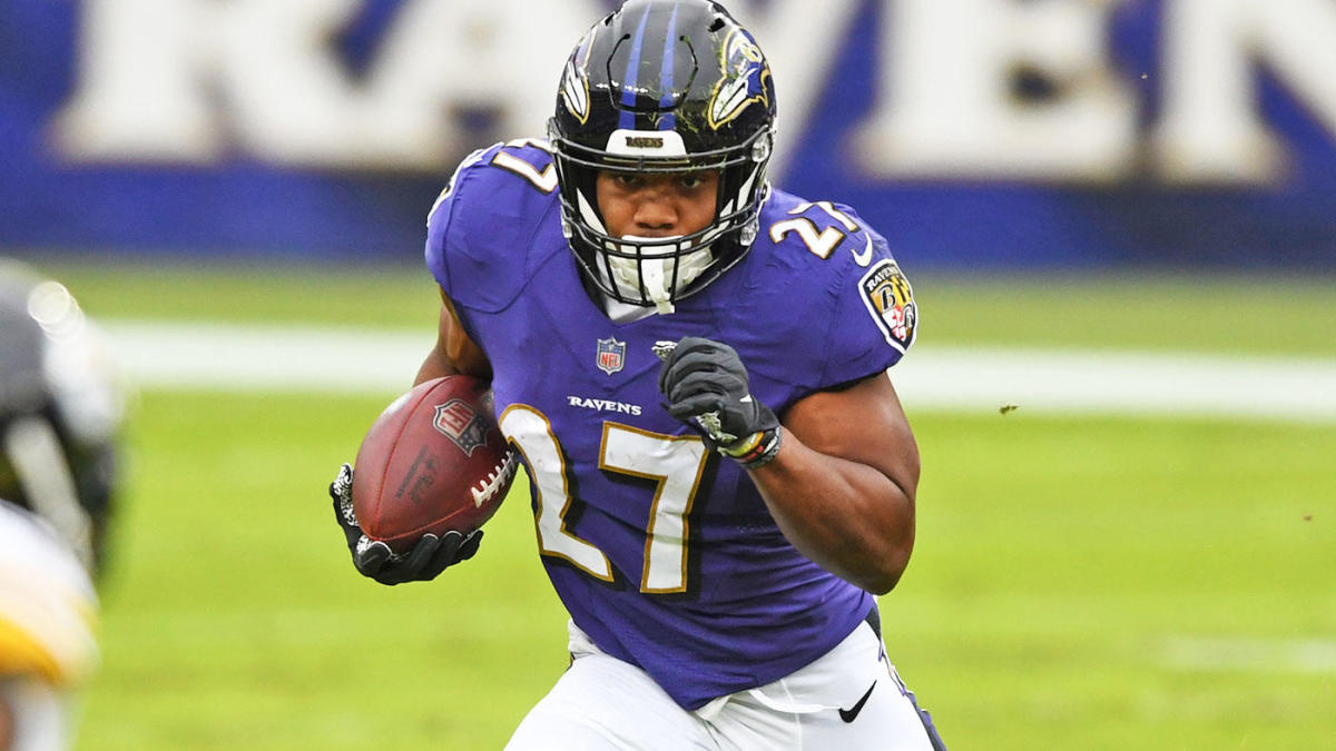 """Currently injured Ravens running back J.K. Dobbins carrying the ball during a game. """"pictured here"""""""